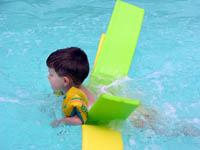 photo of boy in pool with floaties