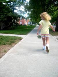 hild walking on sidewalk