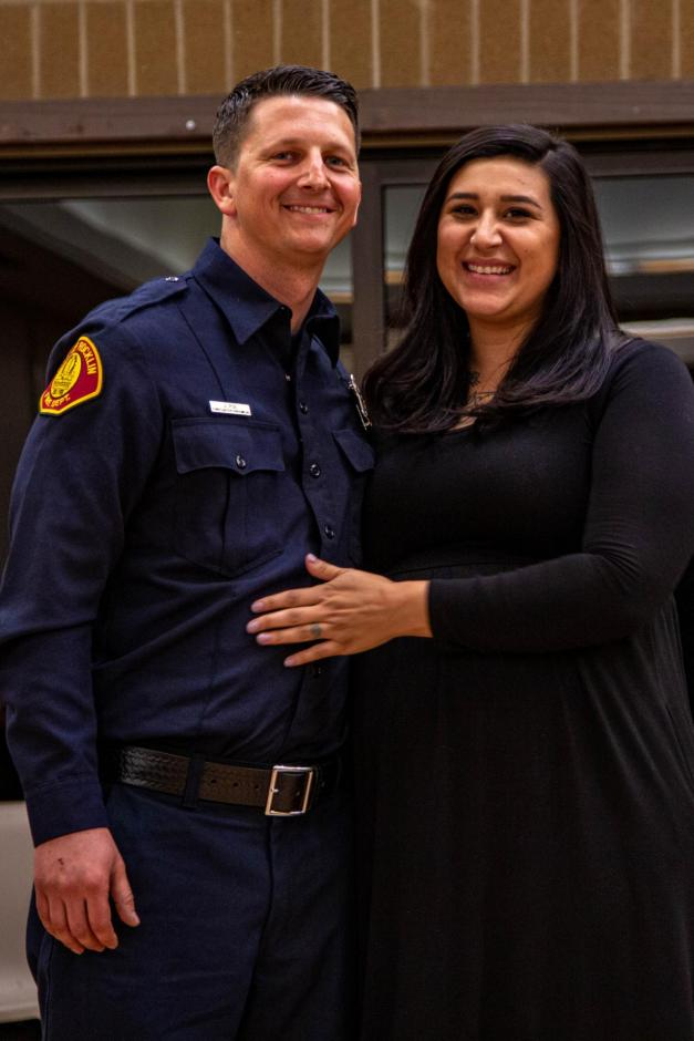 New Rocklin firefighter Jordan Poe smiles with his wife at the hiring ceremony.