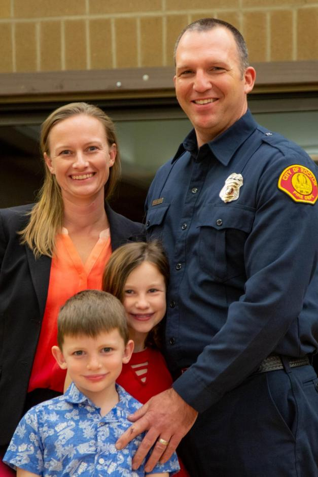 Kevin Stenson stands with his family as a new Rocklin firefighter.