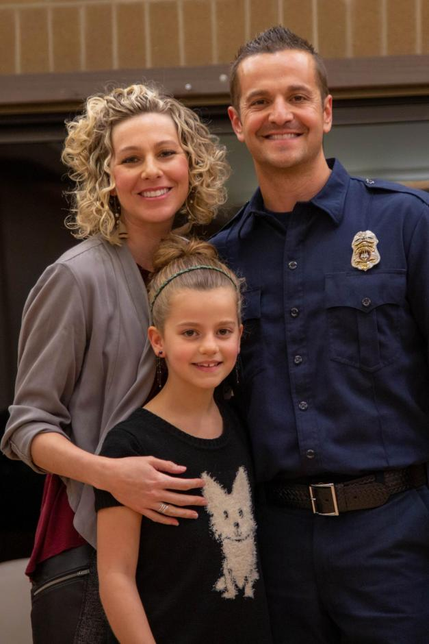 Rocklin firefighter Chris Marson stands with his wife and daughter.