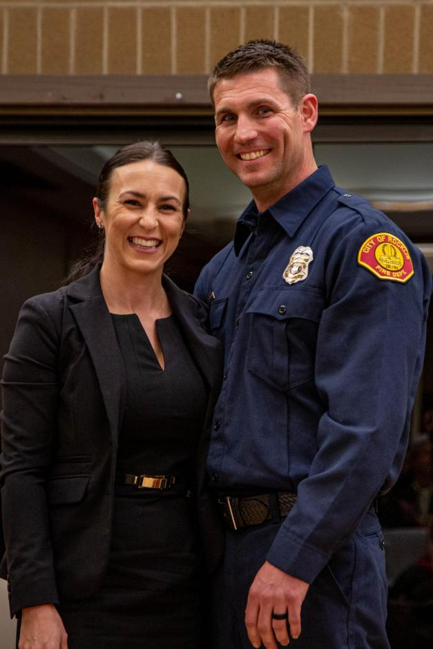 New Rocklin firefighter Erik Garside stands with his wife.