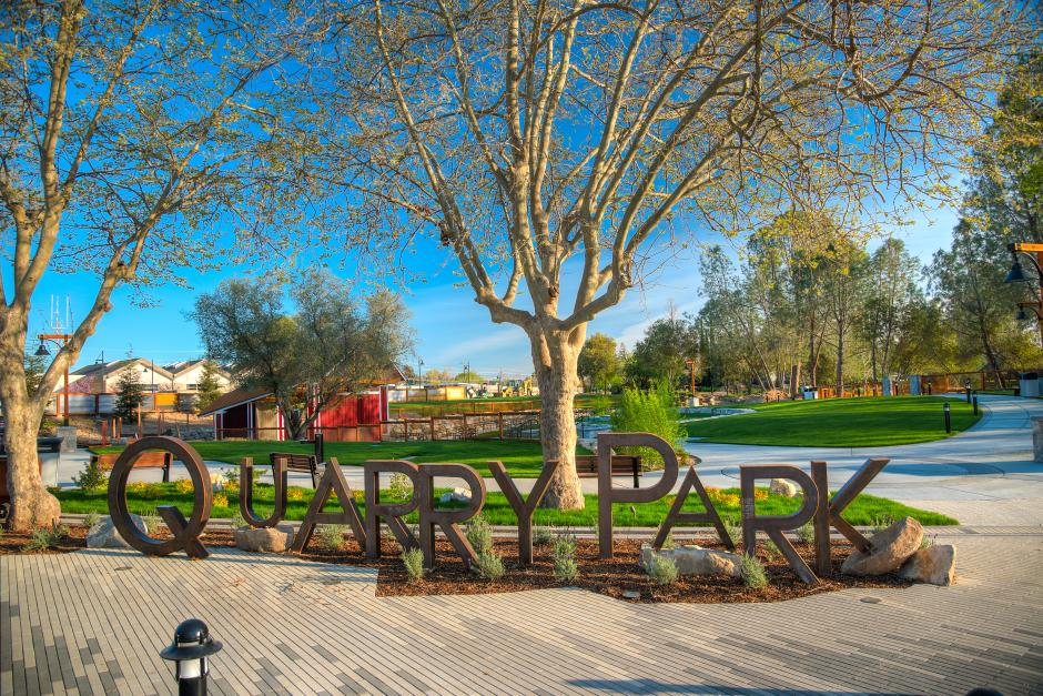 Quarry Park sign with Amphitheatre in the background