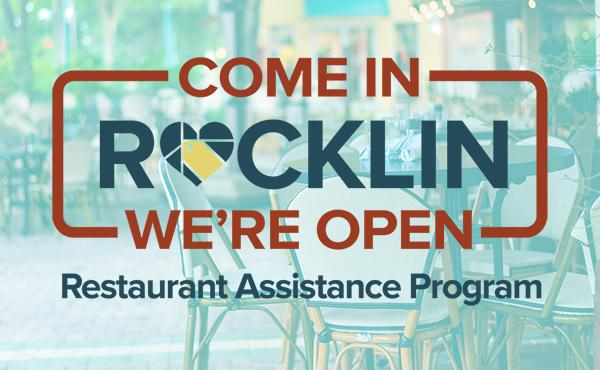 "A photo of Rocklin outdoor dining with the campaign logo in front, reading ""Come In Rocklin, We're Open: Restaurant Assistance Program"""