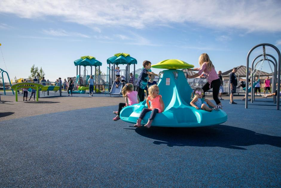 The playground features sensory play equipment that is fun for all ages!