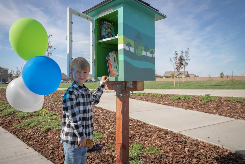 The Free Little Library, installed by a local Eagle Scout  candidate, allows children to pick a book to read.