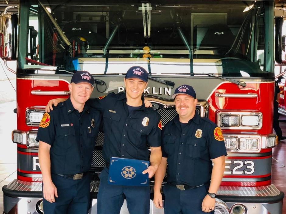 Firefighter-Paramedic Jesse Llopis (center) holds his award with Captain Heath Taylor (left) and Fire Engineer Edward Jimison (right), who were also part of the Rocklin team assigned to Colfax.