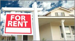 "photo of ""For Rent"" sign in front of a home"
